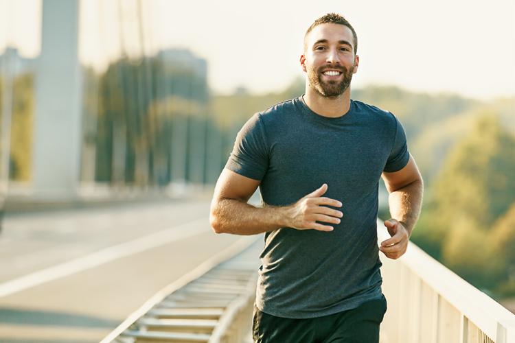 Man jogging on bridge