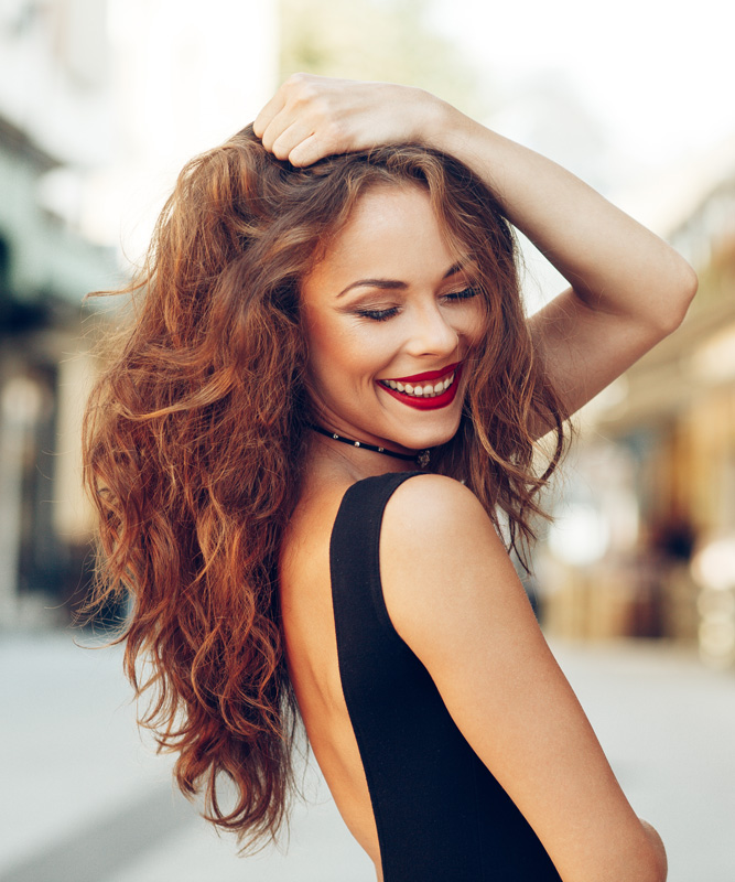 Woman looking back with hand in hair