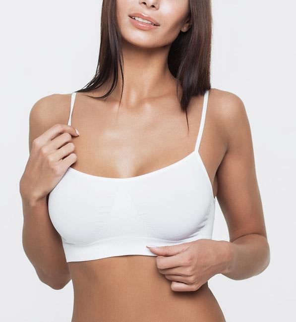 Woman adjusting top